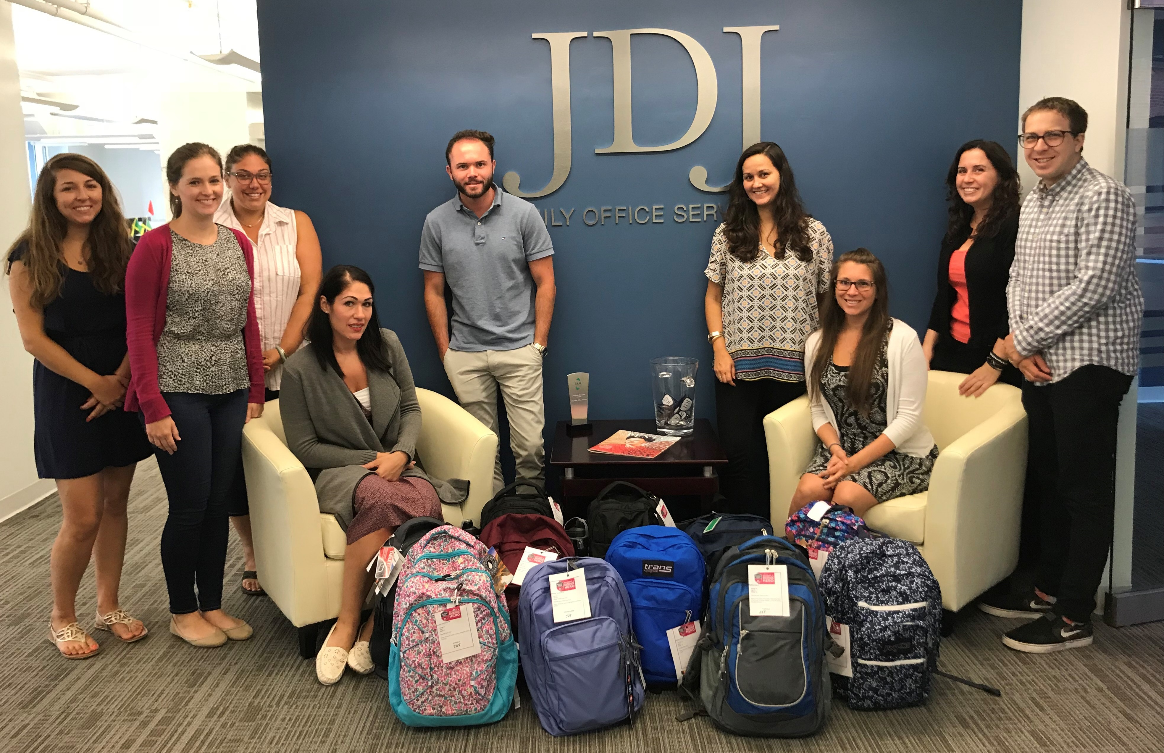 Pictured above, a few of this year's JDJ Backpack Heroes with backpacks full of supplies, (from left): Gina Perrotta, Elizabeth Fogarty, Elana Vasi, Rachel DeIeso, Christian Flavin, Mallory Garneau, Angela Simmons, Vicki Saris, Stafford Turnage. Additional heroes are not pictured.